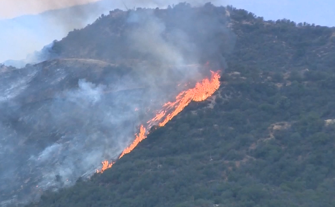 Sun Valley brush fire threatens homes, forces evacuations, shuts down 210 Freeway