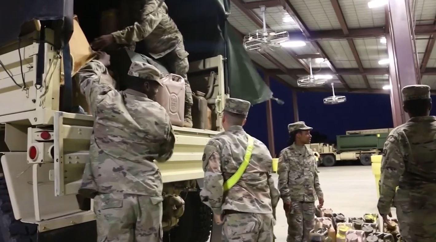 Soldiers prepare convoy trucks for movement at Fort Bragg, North Carolina.
