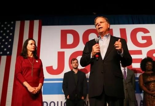 (AP Photo/John Bazemore). Democratic candidate for U.S. Senate Doug Jones speaks during a rally Monday, Dec. 11, 2017, in Birmingham, Ala. Jones is facing Republican Roy Moore.