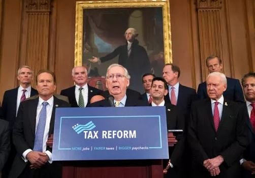 (AP Photo/J. Scott Applewhite, file). FILE - This Sept. 27, 2017 file photo shows Senate Majority Leader Mitch McConnell, R-Ky., center, joining Speaker of the House Paul Ryan, R-Wis., and other GOP lawmakers to talk about the tax plan